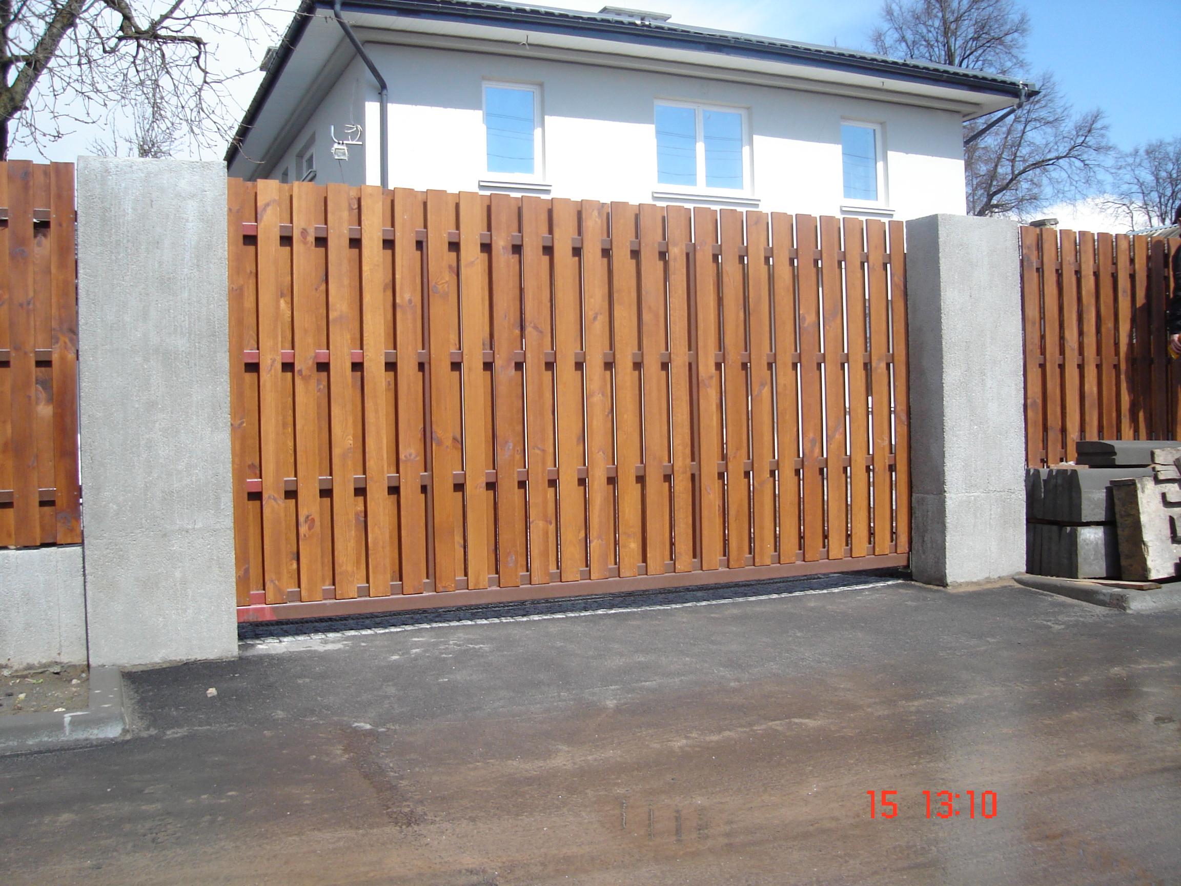 Как сделать ворота для гаража своими руками из дерева